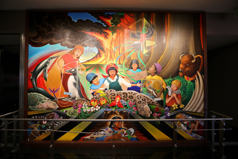 One of the most startling things in the Denver airport are the murals that line the walls on Level 5 of the Jeppesen Terminal. Many think that the murals, painted by artist Leo Tanguma, tell the story of apocalyptic biowarfare destroying the world as we know it, with the New World Order taking over in its place.